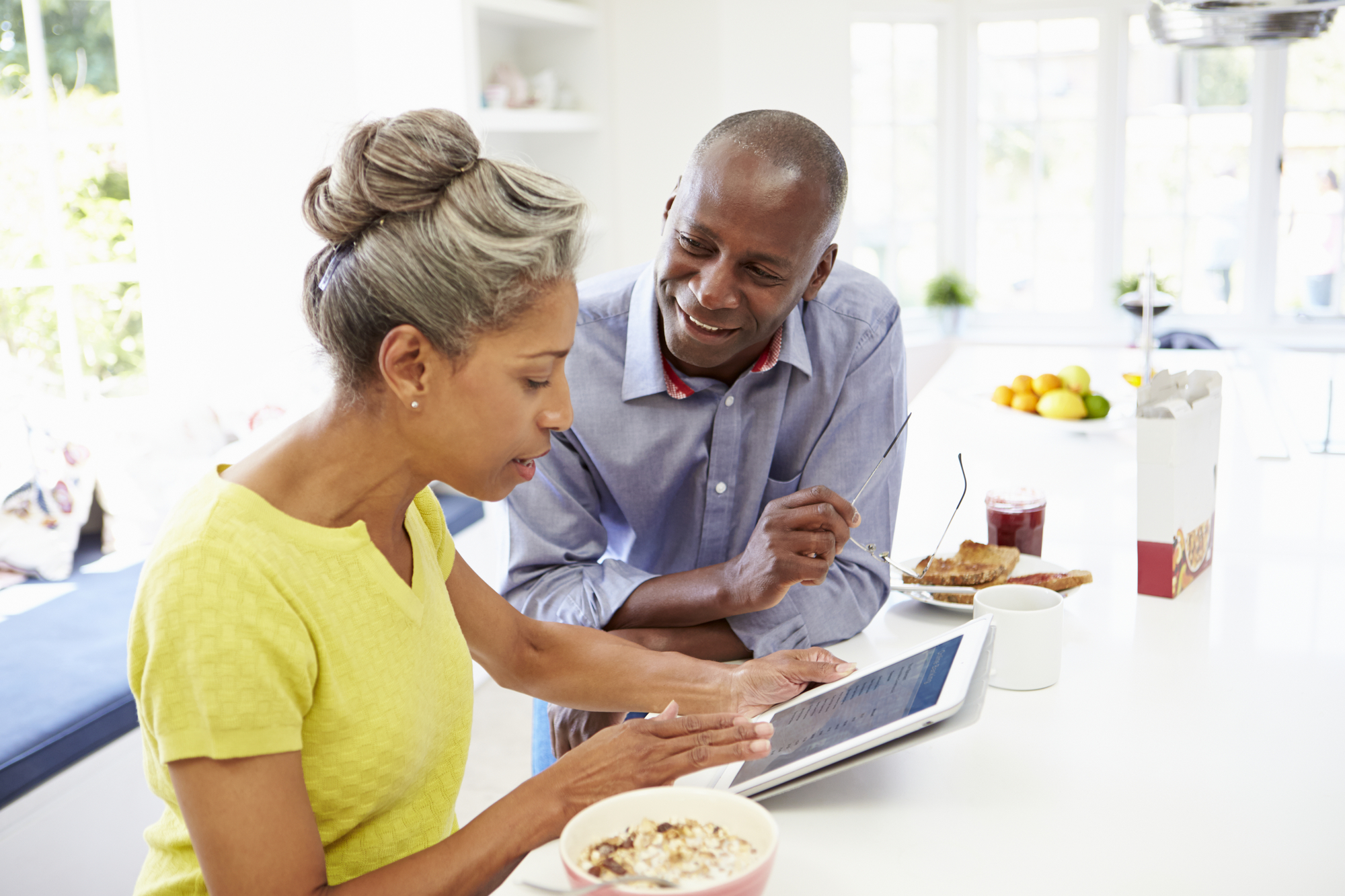 African American Couple Using Digital Tablet