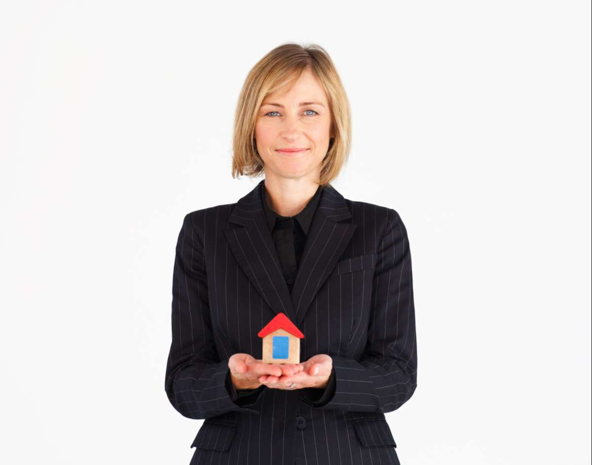 Well-dressed mature woman dreaming of new house (R) (S)
