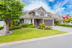 A large, luxurious house with a beautiful front yard, much like the rental properties where GTL Real Estate can provide Decatur property management