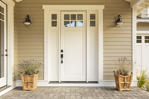 An elegant front door with a nice porch, like you might find at a property where GTL Real Estate provides Douglasville property management.