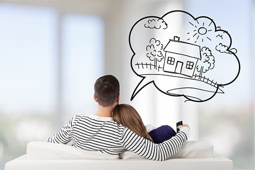 A photo of couple snuggling on the couch from the back, with a caption of a drawing of a house.
